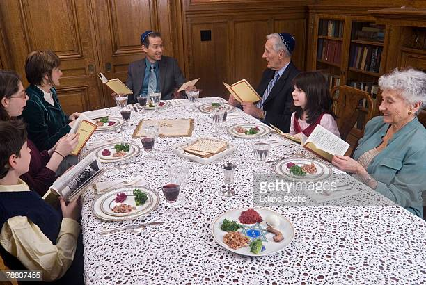 family celebrating passover - happy passover stock pictures, royalty-free photos & images