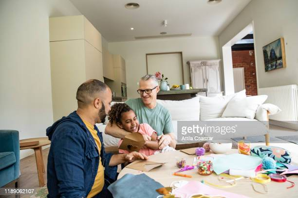 lgbtqi family celebrating valentine's day at home - art and craft stock pictures, royalty-free photos & images