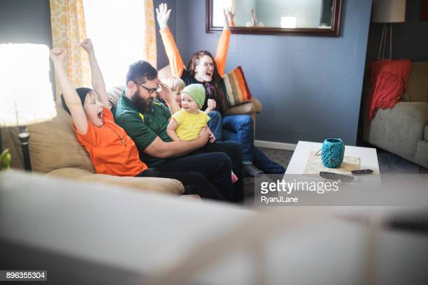 Family Celebrating While Watching Football Game