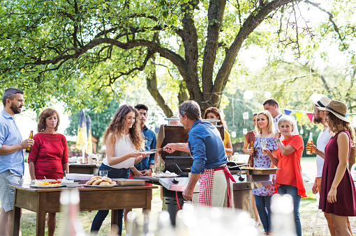 Family celebration or a barbecue party outside in the backyard. 966953350