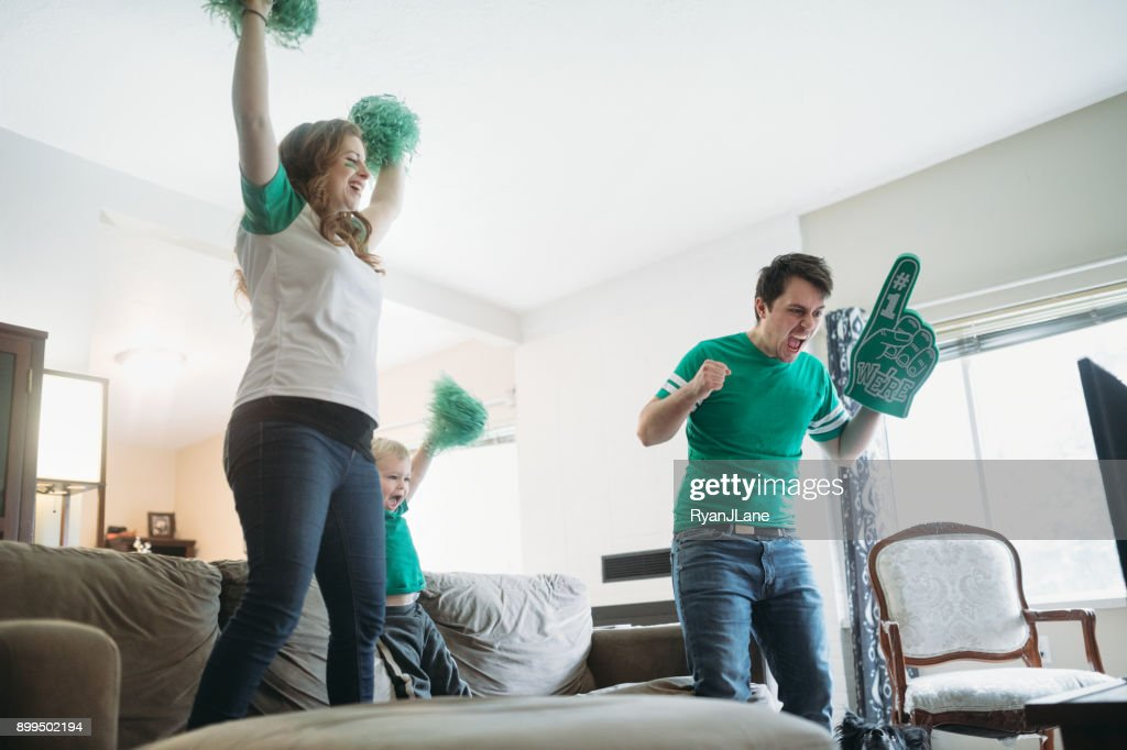 Family Cheering While Watching Football Game : Stock Photo