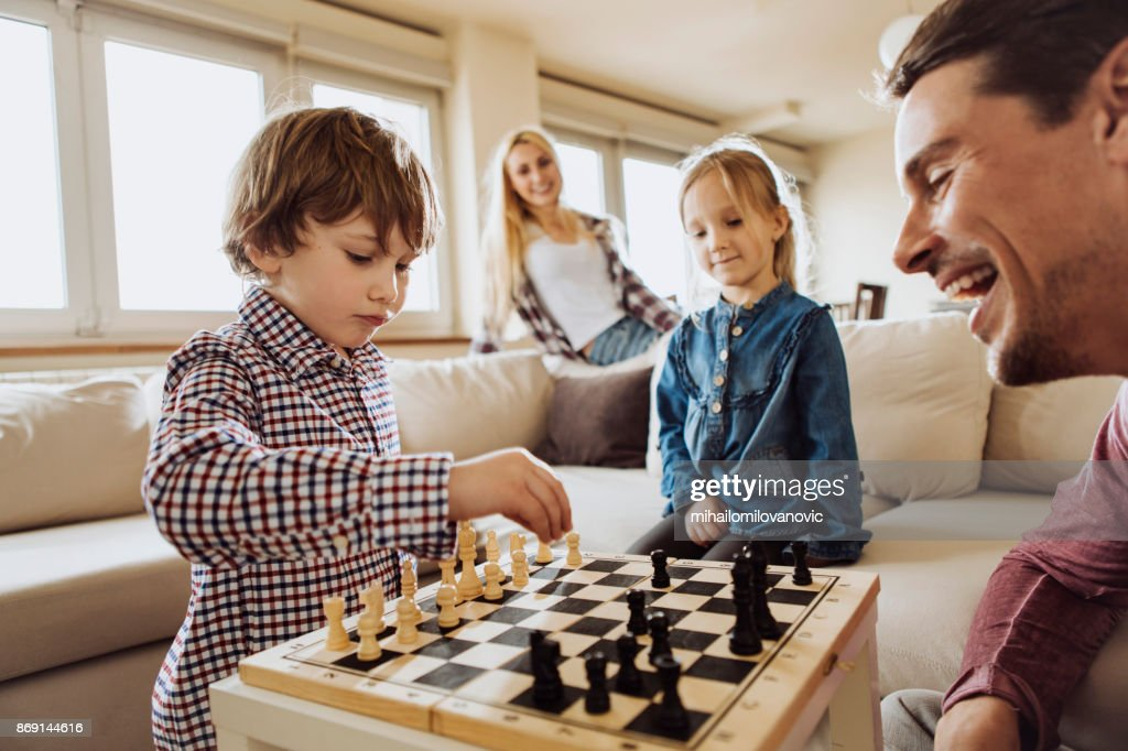 Family chess game : Stock Photo