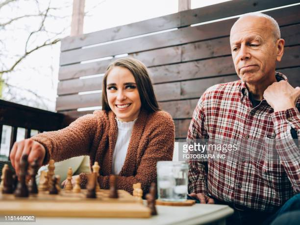 family chess time - niece stock pictures, royalty-free photos & images
