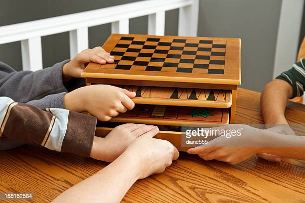 family choosing board games to play - game night stock photos and pictures