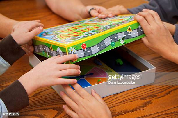 family choosing board games to play - board game stock pictures, royalty-free photos & images