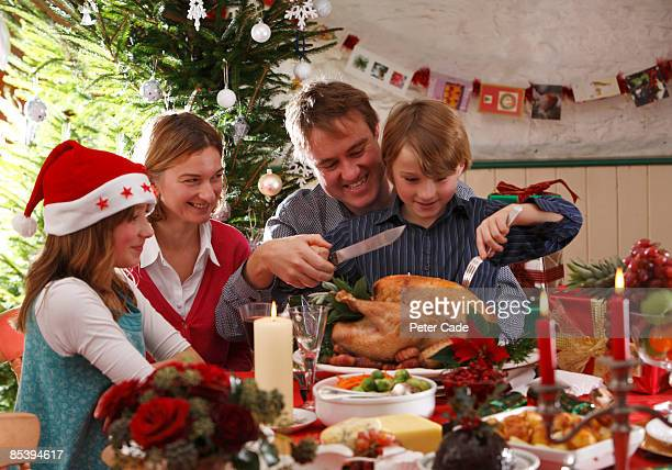 family christmas carving turkey - two generation family stock pictures, royalty-free photos & images