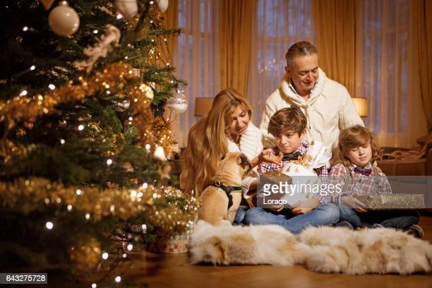 Family christmas scene with festive decorations in warm indoor setting