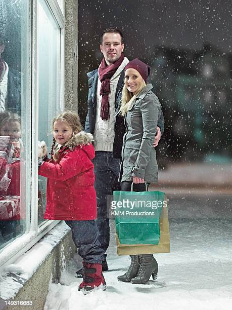Family Christmas shopping in snow