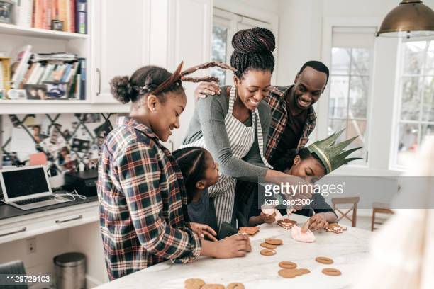 family christmas traditions - sugar cookies - tradition stock pictures, royalty-free photos & images