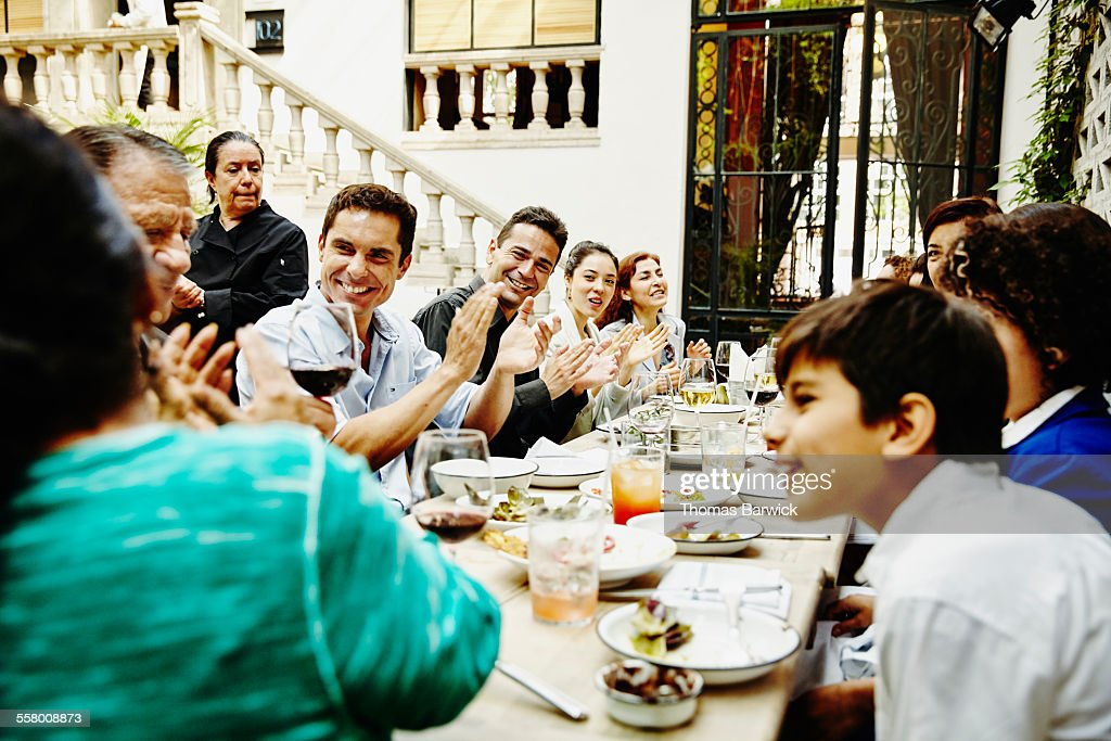 Family clapping for grandfather during party : Stock Photo