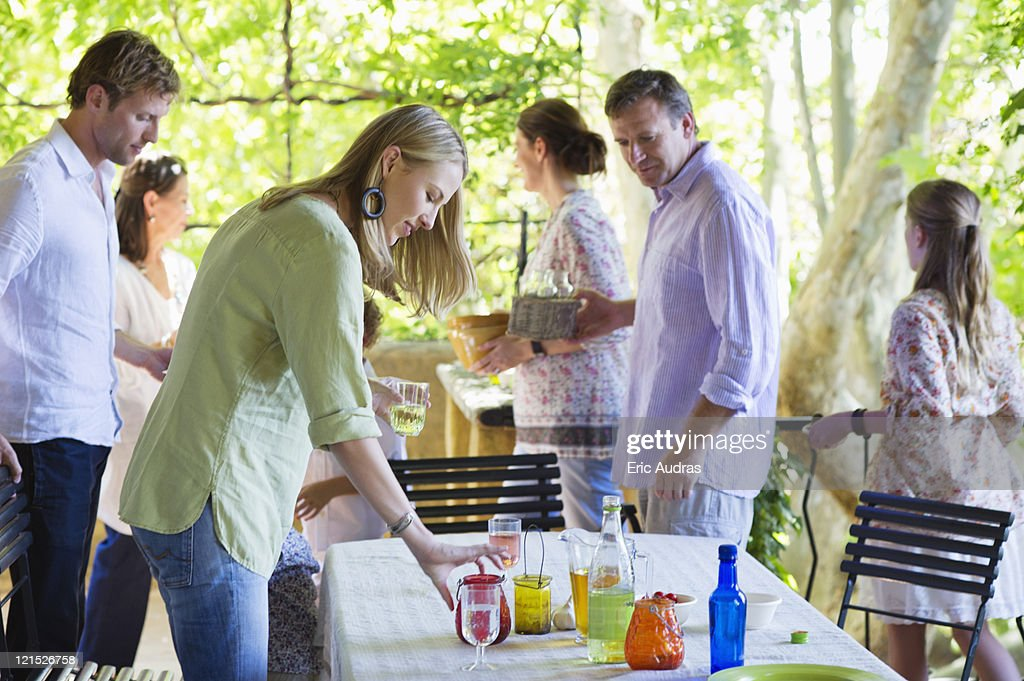 Family cleaning table after having food at house : Stock Photo