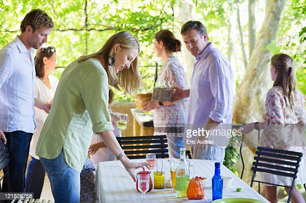 family cleaning table after having food at house - cleaning after party stock pictures, royalty-free photos & images