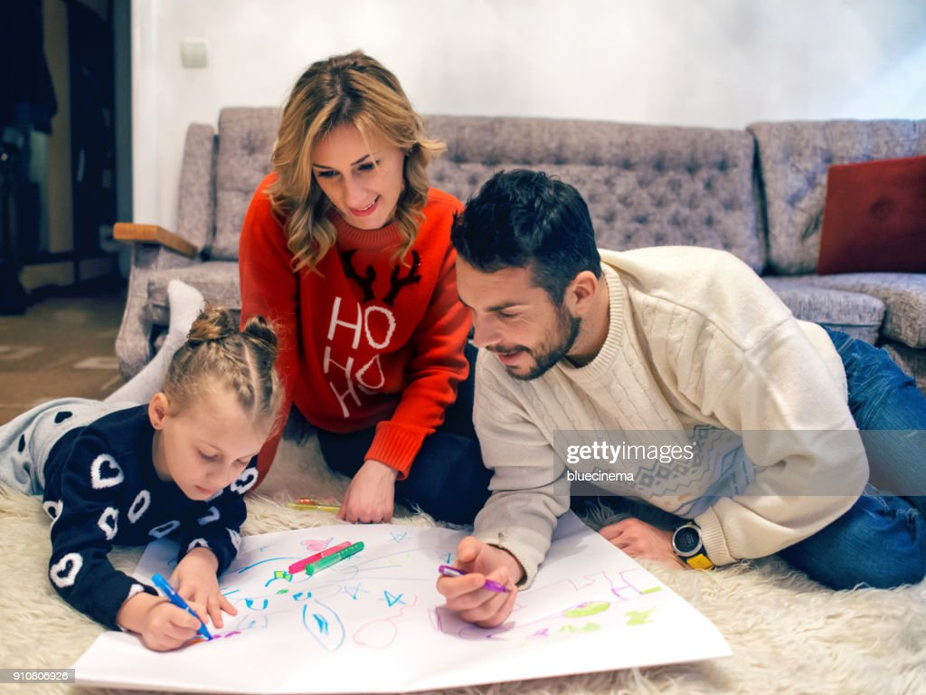 Family Coloring Together At Home Stock Photo | Getty Images