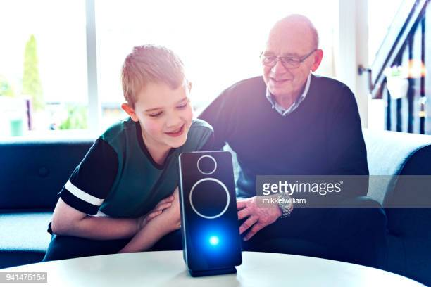 Family communicates with digital assistant which help them in their daily life