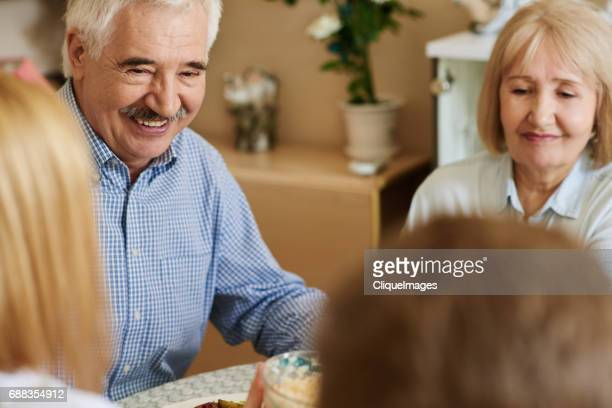 family communicating at dining table - cliqueimages stock pictures, royalty-free photos & images