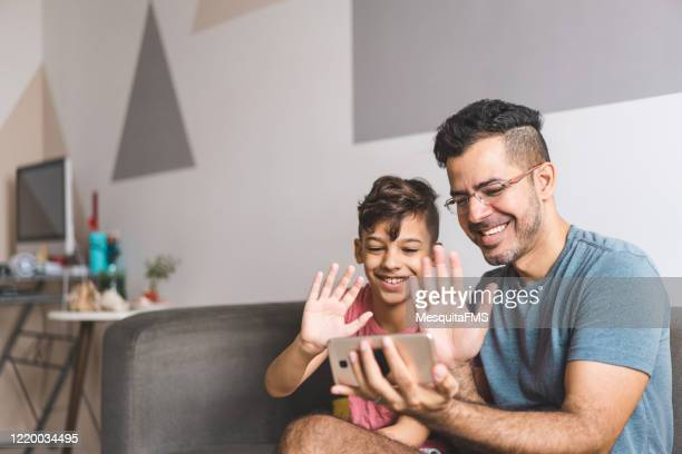 family communicating by video conference - fathers day stock pictures, royalty-free photos & images