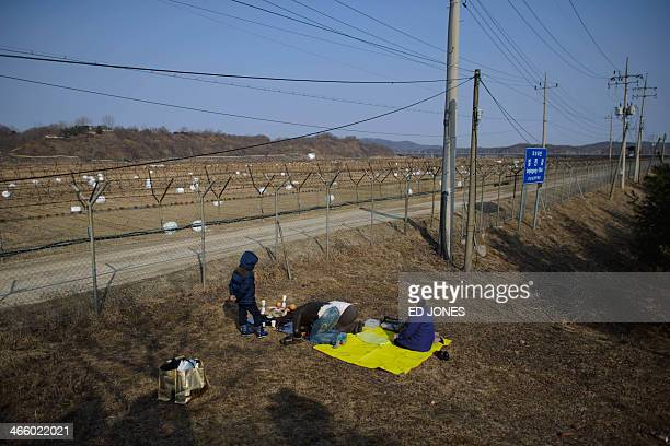 Family conduct a memorial ceremony for relatives in North Korea, near the Freedom Bridge at the Demilitarized Zone at Imjingak, Paju, in South...