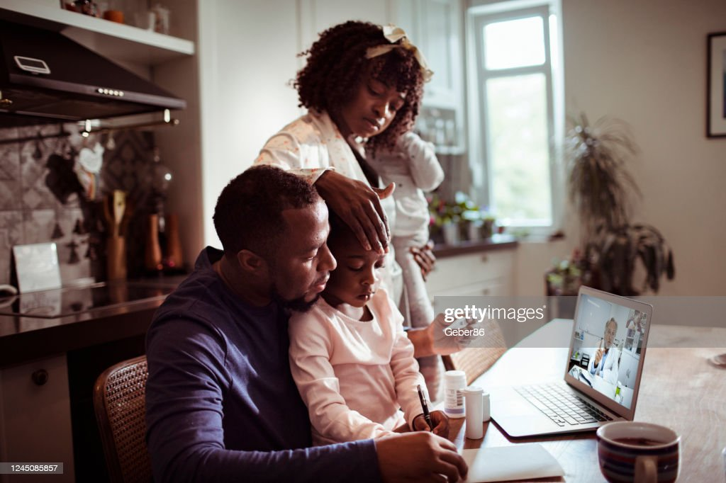 Family Consulting with their Doctor : Stock Photo