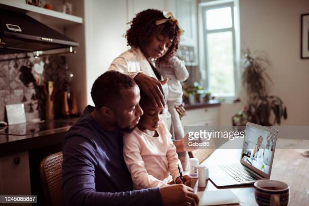 family consulting with their doctor - telemedicine stock pictures, royalty-free photos & images