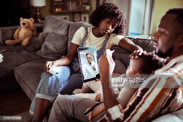 family consulting with their doctor - pandemic illness stock pictures, royalty-free photos & images