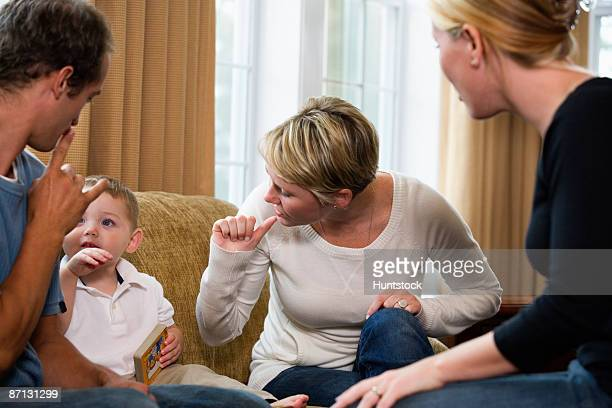 Family conversing in sign language