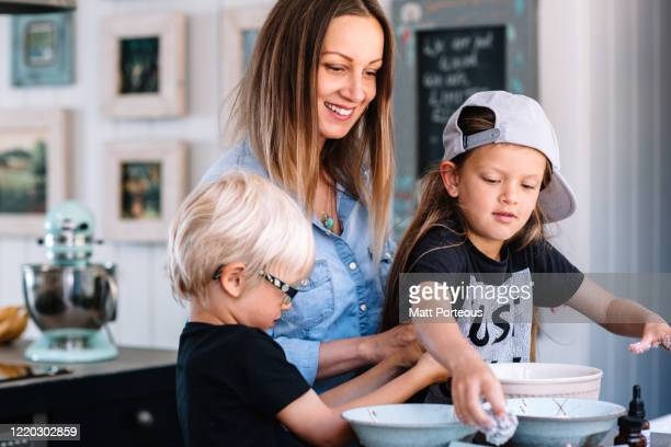 family cooking at home in kitchen - mother stock pictures, royalty-free photos & images