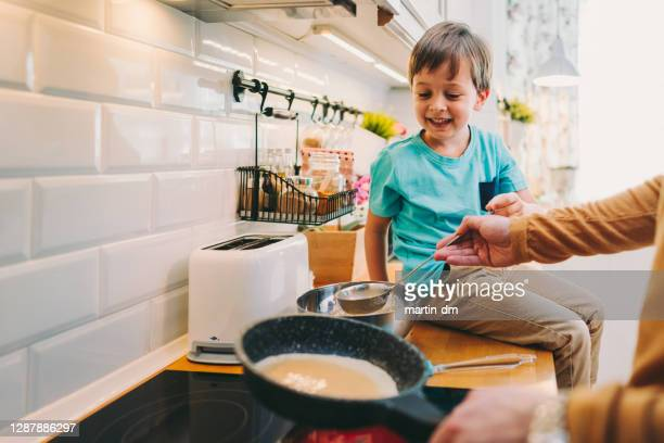 family cooking at home - pancakes stock pictures, royalty-free photos & images