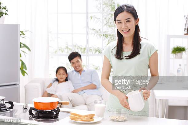Family cooking breakfast in kitchen
