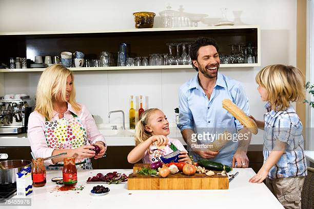A family cooking dinner together.