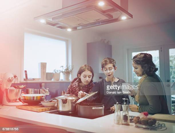 Family cooking food in kitchen