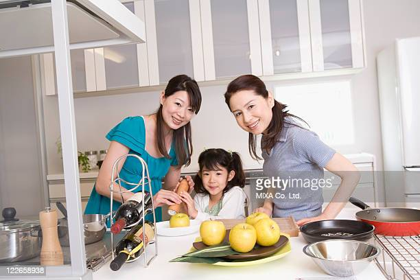 Family cooking in kitchen