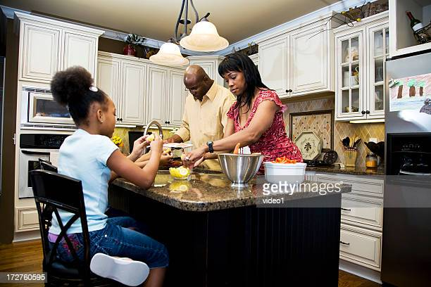 A family cooking in the kitchen