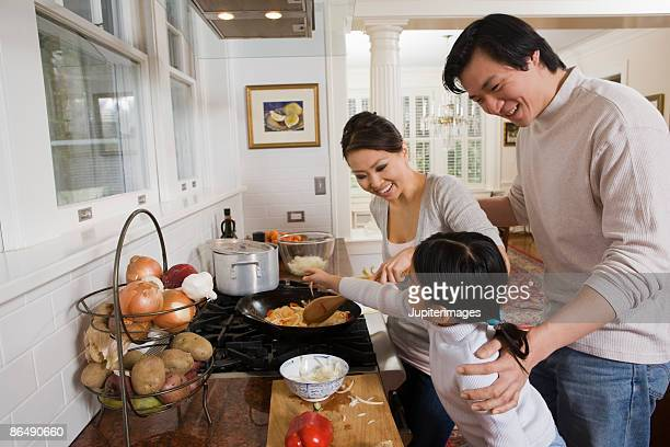 family cooking in the kitchen - vietnamese culture stock pictures, royalty-free photos & images