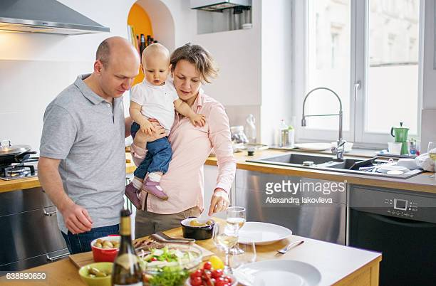 Family cooking lunch together at home