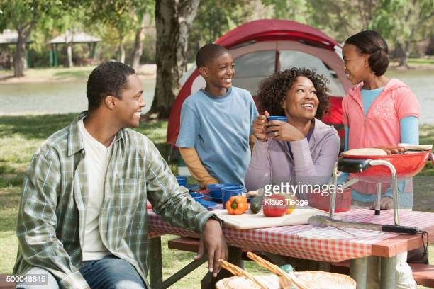 Family cooking together at campsite