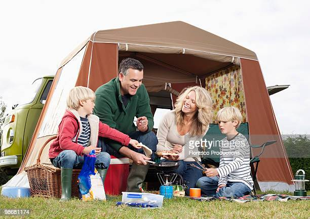 Family cooking together outdoors