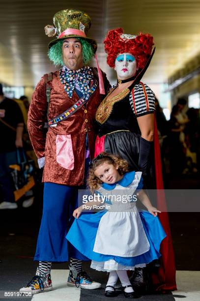A family cosplays as The Mad Hatter The Queen of Hearts and Alice from Alice In Wonderland during the 2017 New York Comic Con Day 4 on October 8 2017...