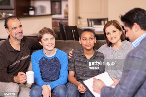 family counseling session at home with therapist. - minority groups stock pictures, royalty-free photos & images