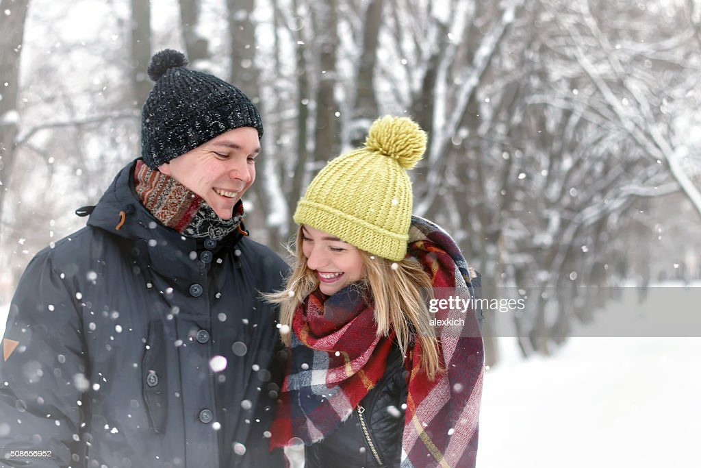 family couple walk winter snow : Stock Photo