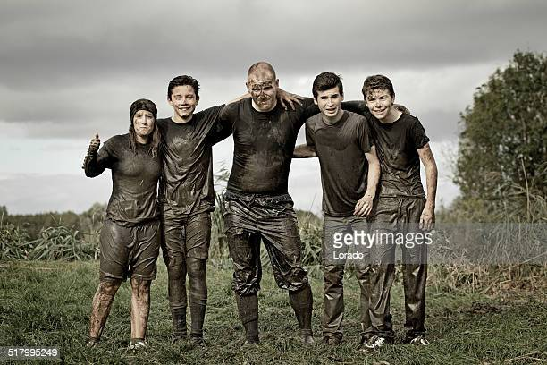 family covered by dirt during mud run