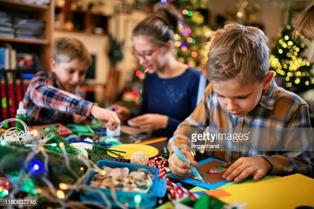 family crafting christmas cards - preparation stock pictures, royalty-free photos & images
