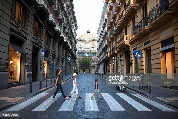 family crossing a pedestrian crossing