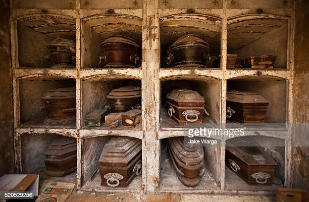 family crypt with old coffins, la recoleta cemetery, argentina, buenos aires - クリプト ストックフォトと画像