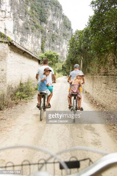 A family cycle through rural landscape in Ninh Binh