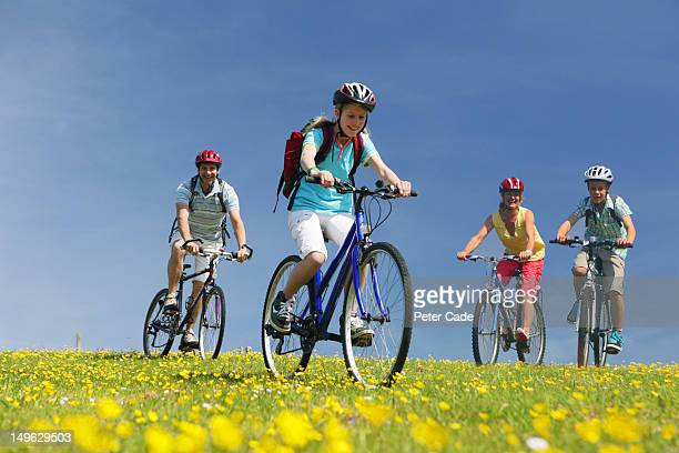 family cycling in field