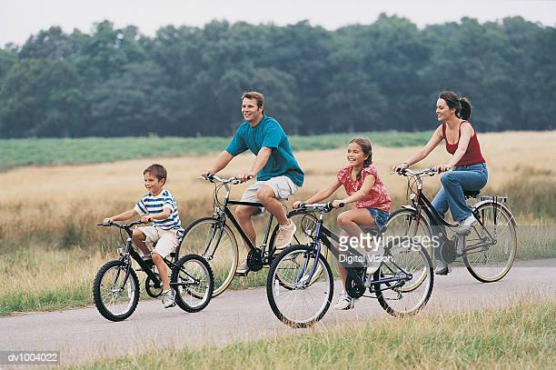 Family Cycling on a Country Road
