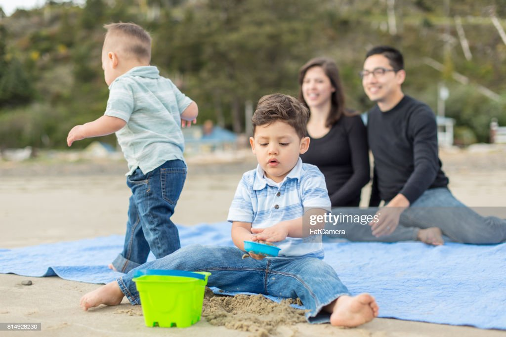 Family day at the beach : Stock Photo