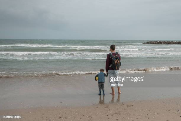 family day on the beach - bouches du rhone stock pictures, royalty-free photos & images