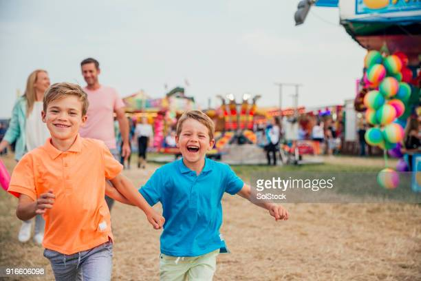 family day out at the fairground - carnival stock photos and pictures
