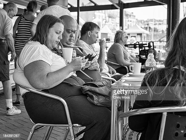 CONTENT] A family day out to Barry Island in South Wales Stopping for a coffee break in the seafront cafe Whole family all using mobile phones at the...